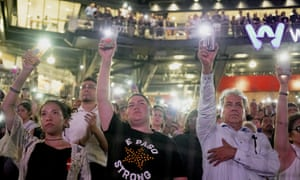 People attend a community memorial service honoring victims of the mass shooting in El Paso.
