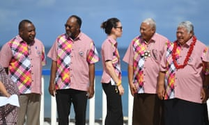 The leaders of Papua New Guinea, Vanuatu, New Zealand, Fiji and Samoa talk before the group photo at the Pacific Island Forum.