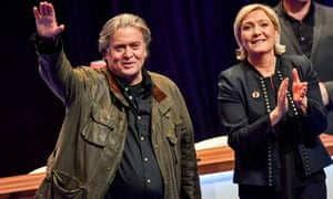 Marine Le Pen, president of France's far-right National Rally (formerly National Front) party, applauds the former US presidential adviser Steve Bannon after his speech at the party's annual congress in March 2018.