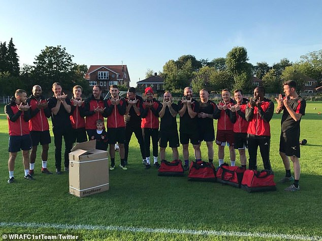 Lingard (eighth from the left) got the Whalley Range players to do his signature 'JLingz' pose