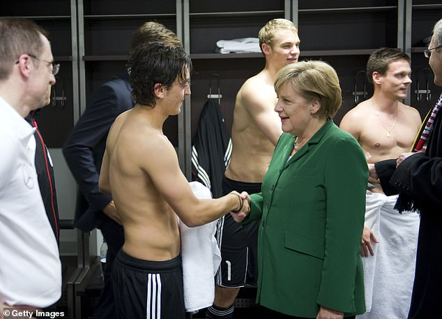 In 2010, Germany's Angela Merkel (right) was criticised for a picture with Ozil after a match
