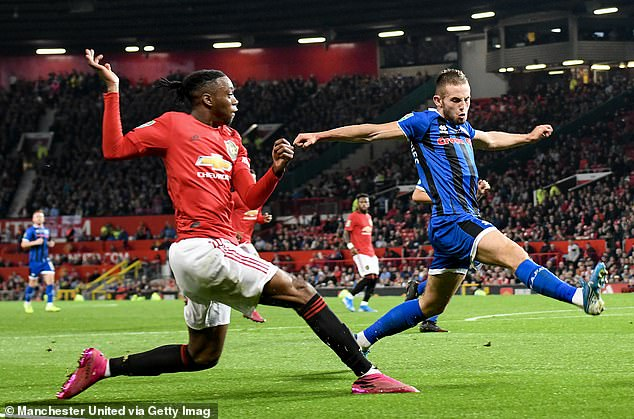 United are to welcome back Aaron Wan-Bissaka (left) after his recent injury lay-off