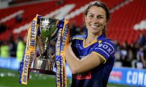 Courtney Hill holds the Betfred Women's Super League Grand Final aloft.