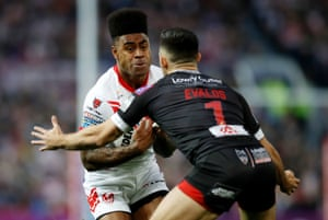 St Helens' Kevin Naiqama (left) and Salford Red Devils' Niall Evalds in action.