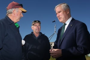 Deputy PM and Nationals leader, Michael McCormack, with a couple of protesters.