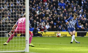 Brighton's Solly March shoots into the side netting.