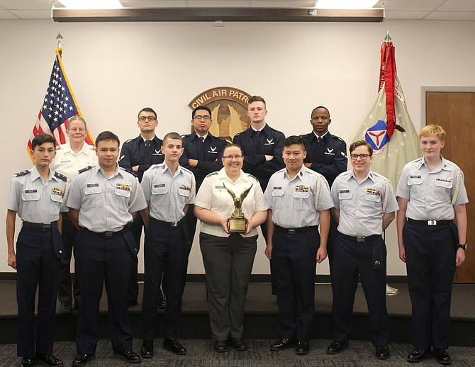 The Burke Cadet Team with the winning trophy and the Joint Base Langley-Eustis Honor Guard judges in the back row.