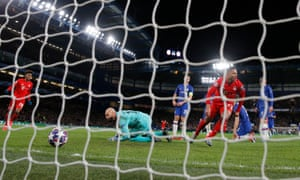 Serge Gnabry of Bayern Munich celebrates after he scores his team's first goal during the UEFA Champions League round of 16 first leg match between Chelsea FC and FC Bayern Muenchen at Stamford Bridge on February 25, 2020 in London, United Kingdom.