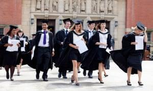 Graduates leave a degree ceremony at Birmingham University.