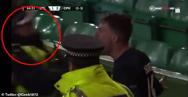 The policeman circled was sent flying after trying to break up Copenhagen's celebrations
