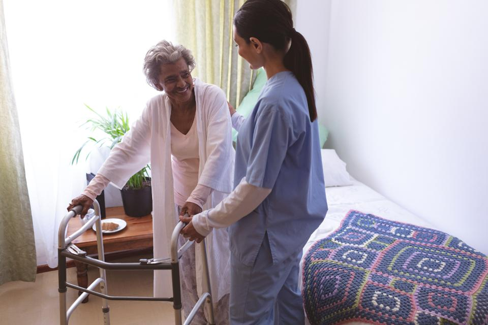 Female nurse helping senior female patient with walker, ageism, gerontological society of America, ageism training
