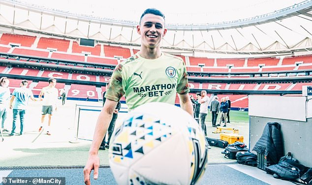 Phil Foden, who didn't feature on Wednesday, smiles at training at the Wanda Metropolitano