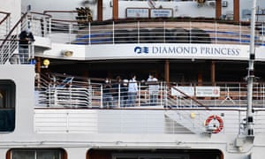 Crew members prepare to disembark the Diamond Princess in Yokohama