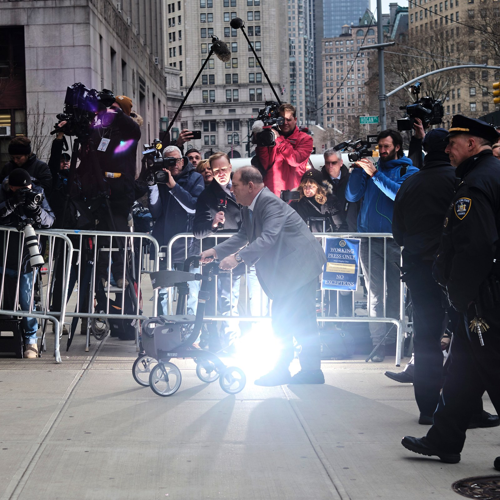 Harvey Weinstein walks toward the courthouse.