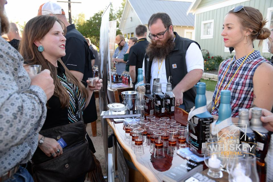 Attendees sample whiskey from Garrison Brothers Distillery