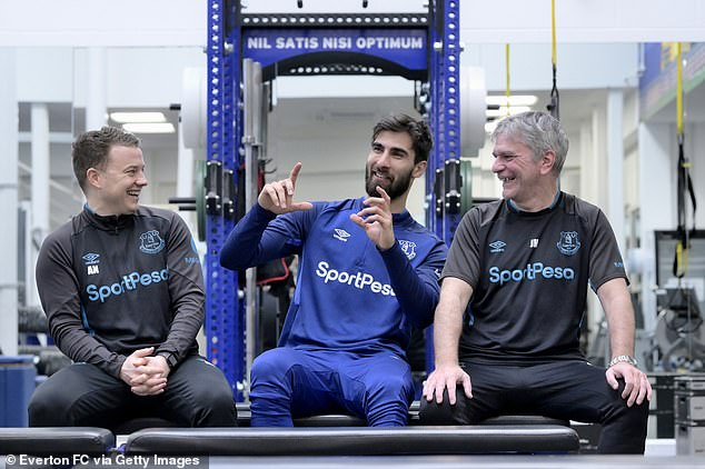 Everton doctor John Hollingsworth (right) put the ankle back in place with Gomes on pitch