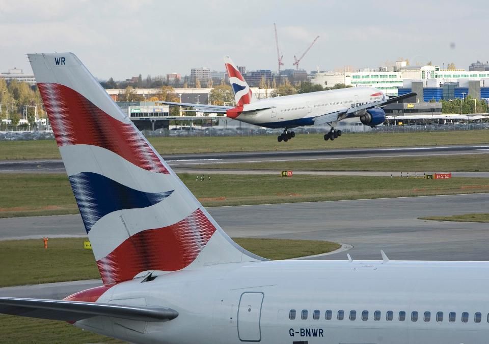 A British Airways airplane lands at Heathrow airport.