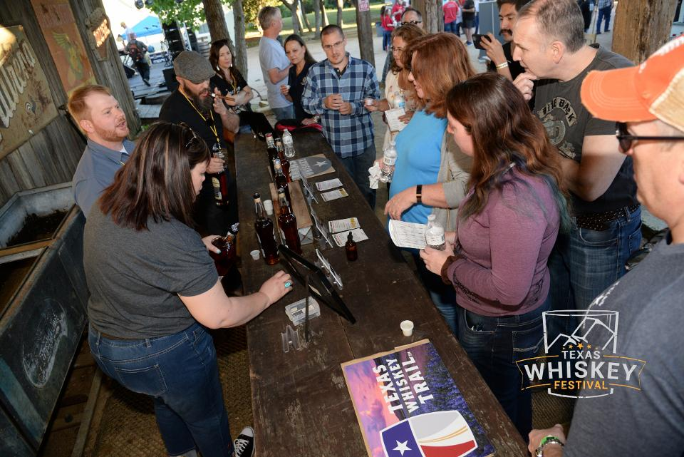 Guests gather at Ironwood Republic's booth for a tasting at last year's Texas Whiskey Festival.