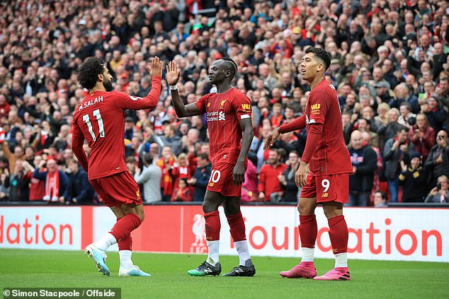 Mo Salah (left), Sadio Mane (centre) and Roberto Firmino are the world's current best attack