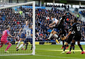 Brighton & Hove Albion's Lewis Dunk heads goalwards.