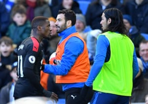 Crystal Palace's Wilfried Zaha is pushed back by teammate Luka Milivojevic after clashing with Brighton & Hove Albion sub Ezequiel Schelotto.