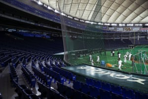 Yomiuri Giants baseball players take part in a practice session behind closed doors amid the spread of the new coronavirus, at the Tokyo Dome in Tokyo, Japan, February 29, 2020.