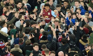 Tyrone Mings is mobbed after Aston Villa's victory in the Carabao Cup semi-final.