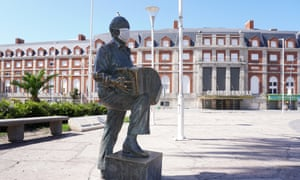 A statue of late musician Astor Piazzolla with a protective face mask in an unusually quiet Central Casino Area on 28 March, 2020 in Buenos Aires, Argentina.