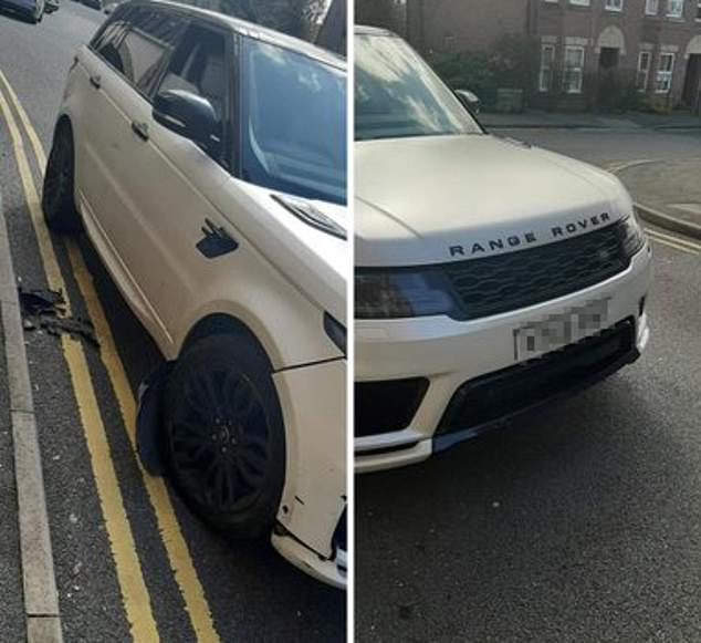 A white Range Rover was pictured damaged after reports of a crash with parked cars