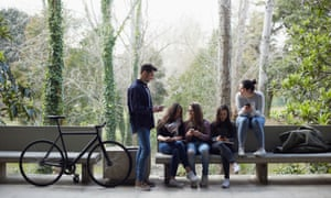 Group Of Young People Talking In A Relaxed Moment In The University Campus