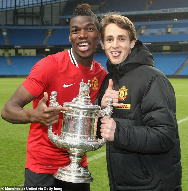 Januzaj poses with Paul Pogba after lifting the Manchester Senior Cup back in May, 2012