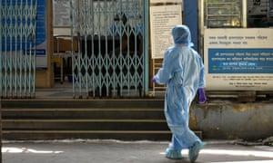 A doctor entering a Covid-19 testing centre wearing protective equipment Coronavirus outbreak, Kolkata, India.