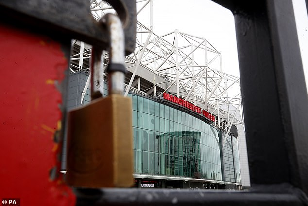 A padlocked gate at Manchester United's Old Trafford stadium during the virus lockdown