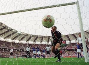 David Seaman watches in horror as Ronaldinho's cross falls into his goal.