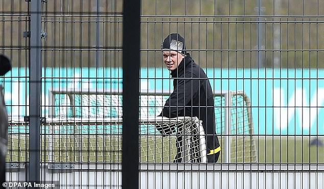 German club Borussia Dortmund returned to limited training on Monday after weeks away