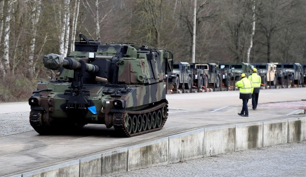 Soldiers of German Army Bundeswehr load a U.S. M109 tank onto a heavy goods transporter during preparations for the Defender-Europe 20 international military exercises in Bergen Hohne