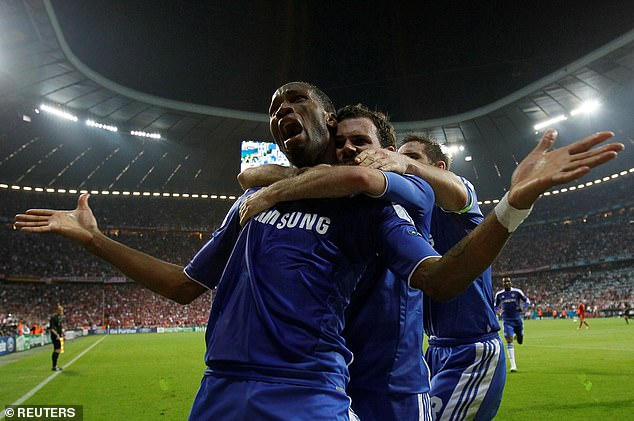 Drogba pictured celebrating alongside Mata, with Frank Lampard joining the wild scenes