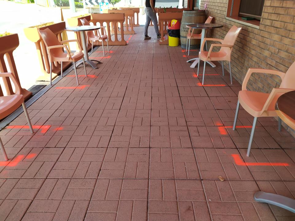 Spray paint to ensure social distancing in bars.